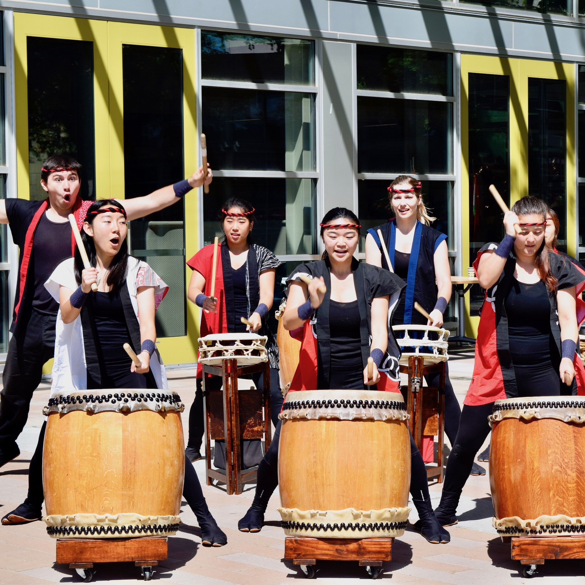 students drumming at event